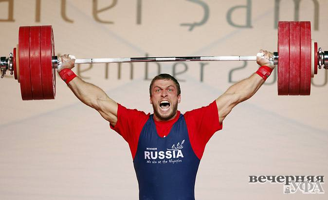 1343327565_f71cf18915649320_2010-09-26t110112z_01_osm01_rtridsp_3_weightlifting